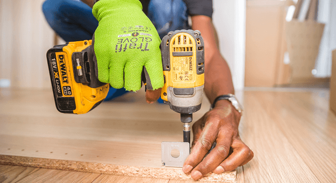 Person using DeWalt Electric Screwdriver to fasten a screw into wood