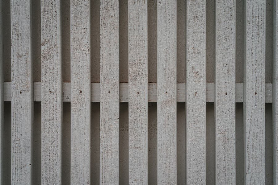 white fence pickets up close